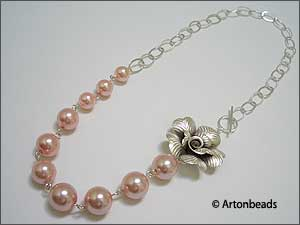 Graduated Pearl Necklace with Sterling Silver Rose